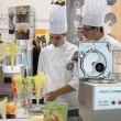 Stock Photo: Young cooks at Host 2013 in Milan, Italy