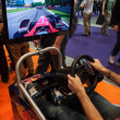 F1 simulator at Games Week 2013 in Milan, Italy — Stock Photo