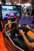 F1 simulator at Games Week 2013 in Milan, Italy — Zdjęcie stockowe