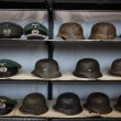 Nazi helmets and hats at Militalia 2013 in Milan, Italy — Stock Photo