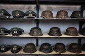 Nazi helmets and hats at Militalia 2013 in Milan, Italy — Stock Photo