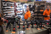 People and softair weapons at Militalia 2013 in Milan, Italy — Stock Photo