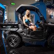 Stock Photo: Beautiful model on off-road vehicle at EICM2013 in Milan, Italy