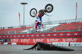 Pilot performs a backflip at EICMA 2013 in Milan, Italy — Stock Photo