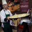 Chef cooking flat bread at Golosaria 2013 in Milan, Italy — Stock Photo #35690291
