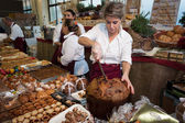 People and panettone at Golosaria 2013 in Milan, Italy — Stock Photo