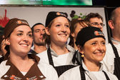 Chef's assistants at Golosaria 2013 in Milan, Italy — Stock Photo