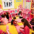 Girls playing inside Barbie's house at G! come giocare in Milan, Italy — Stock Photo