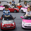 Children driving electric cars at G! come giocare in Milan, Italy — Stock Photo