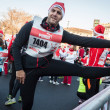 Almost 10.000 Santas take part in the Babbo Running in Milan, Italy — Stock Photo