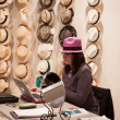 Woman selling hats at HOMI, home international show in Milan, Italy — Stock Photo