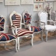 Chairs with flags on display at HOMI, home international show in Milan, Italy — Stok fotoğraf #39490283