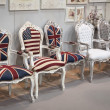 Chairs with flags on display at HOMI, home international show in Milan, Italy — Stock fotografie