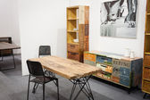 Wooden table with chairs on display at HOMI, home international show in Milan, Italy — Stock Photo