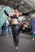 Catwoman cosplayer posing at Festival del Fumetto convention in Milan, Italy — Stok fotoğraf