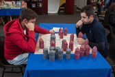 Two guys play a table game at Festival del Fumetto convention in Milan, Italy — Stok fotoğraf