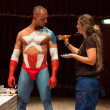 Stok fotoğraf: Bodybuilder during body painting session at Milano Tattoo Convention