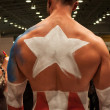 Bodybuilder during a body painting session at Milano Tattoo Convention — Stock Photo #40592441
