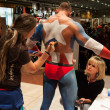 Bodybuilder during a body painting session at Milano Tattoo Convention — Stock Photo