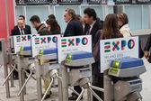 Turnstiles with Expo 2015 logo at Bit 2014, international tourism exchange in Milan, Italy — Stock Photo
