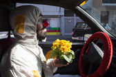 Clown driving his car at Milan Clown Festival 2014 — Stock Photo