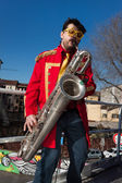 Performer playing music at Milan Clown Festival 2014 — Stock Photo