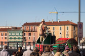 Performer calls people using a vintage loudhailer at Milan Clown Festival 2014 — Stock Photo