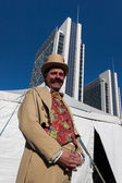 Performer posing outside the big top at Milan Clown Festival 2014 — Stock Photo