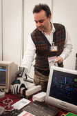 Guy with electronic glove at Robot and Makers Show — ストック写真