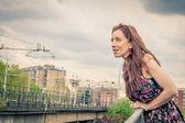 Pretty girl posing on railroad bridge — ストック写真