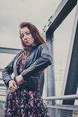 Pretty girl posing on a bridge — Foto Stock