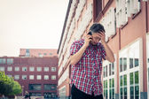 Man in short sleeve shirt talking on phone — Stock Photo