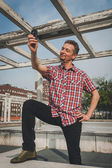 Man in short sleeve shirt taking a selfie — Stock Photo
