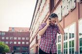 Man in short sleeve shirt talking on phone — Stock Photo