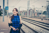 Pretty girl posing along the tracks  — Stock Photo