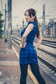 Pretty girl posing along the tracks  — Stock Photo