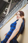 Pretty girl posing in railroad station underpass — Stock Photo