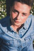 Short hair girl sitting in the grass — Stock Photo