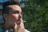Portrait of short hair girl smoking — Stock Photo
