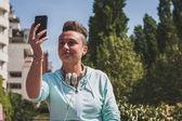 Portrait of a short hair girl taking a selfie — Stock Photo