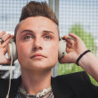 Pretty short hair girl listening to music — Stock Photo #45442613