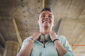 Portrait of a pretty short hair girl with headphones — Stock Photo
