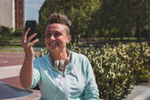 Portrait of a short hair girl taking a selfie — Stock Photo