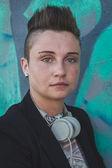Pretty short hair girl posing against a wall — Stock Photo