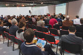 People following a conference at Solarexpo 2014 in Milan, Italy — Stock Photo