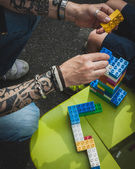 Man helps his son with Lego bricks in Milan, Italy — Stock Photo