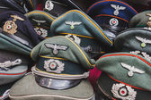 Wehrmacht visor caps on display at Militalia in Milan, Italy — Stock Photo