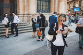 Business people take part in a flash mob in Milan, Italy — Stockfoto