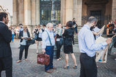 Business people take part in a flash mob in Milan, Italy — Foto Stock