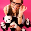 Portrait of beautiful woman posing on pink background in glasses — Stock Photo